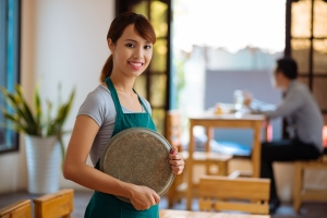 Beautiful waitress with a tray